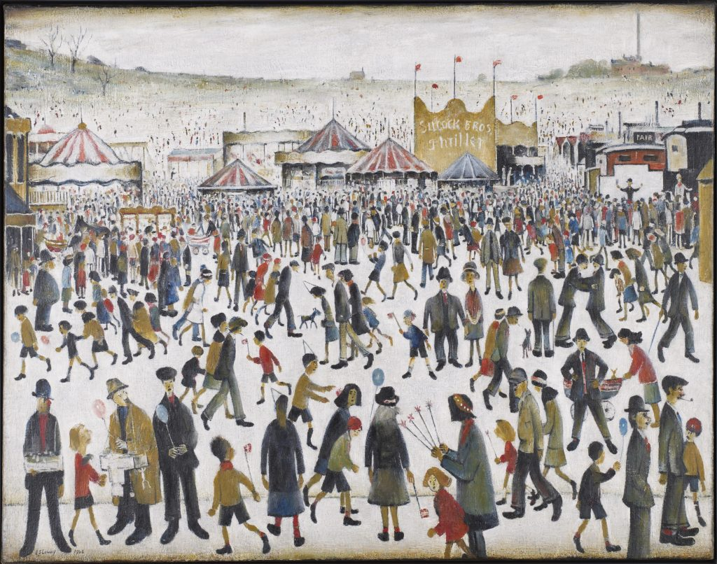 Crowd scene of people at a funfair
