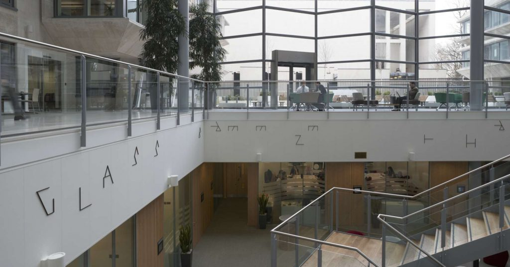 A text-based artwork installed on the mezzanine of a public building
