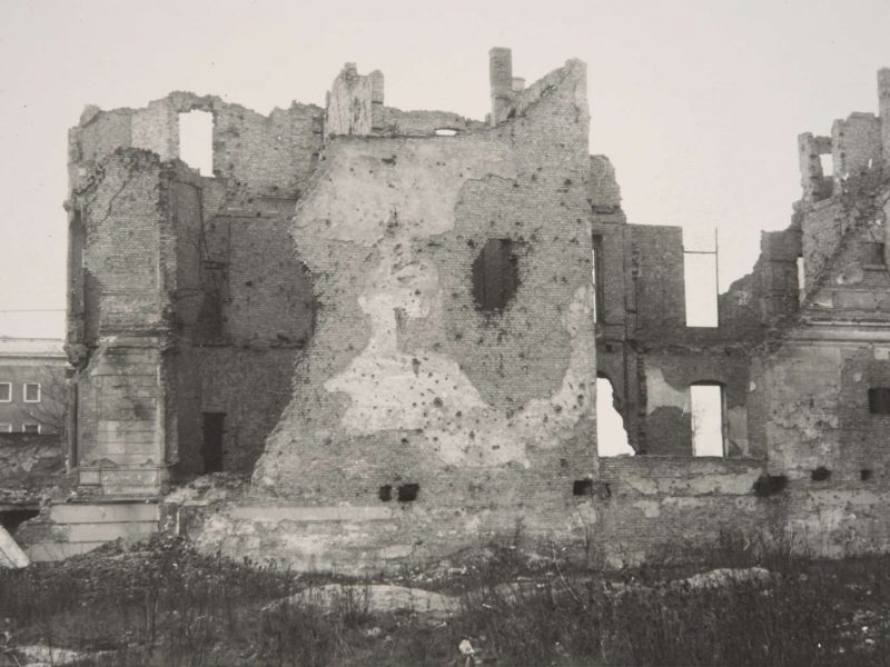 A black-and-white photographs showing the rubble of the destroyed British Embassy in 1954