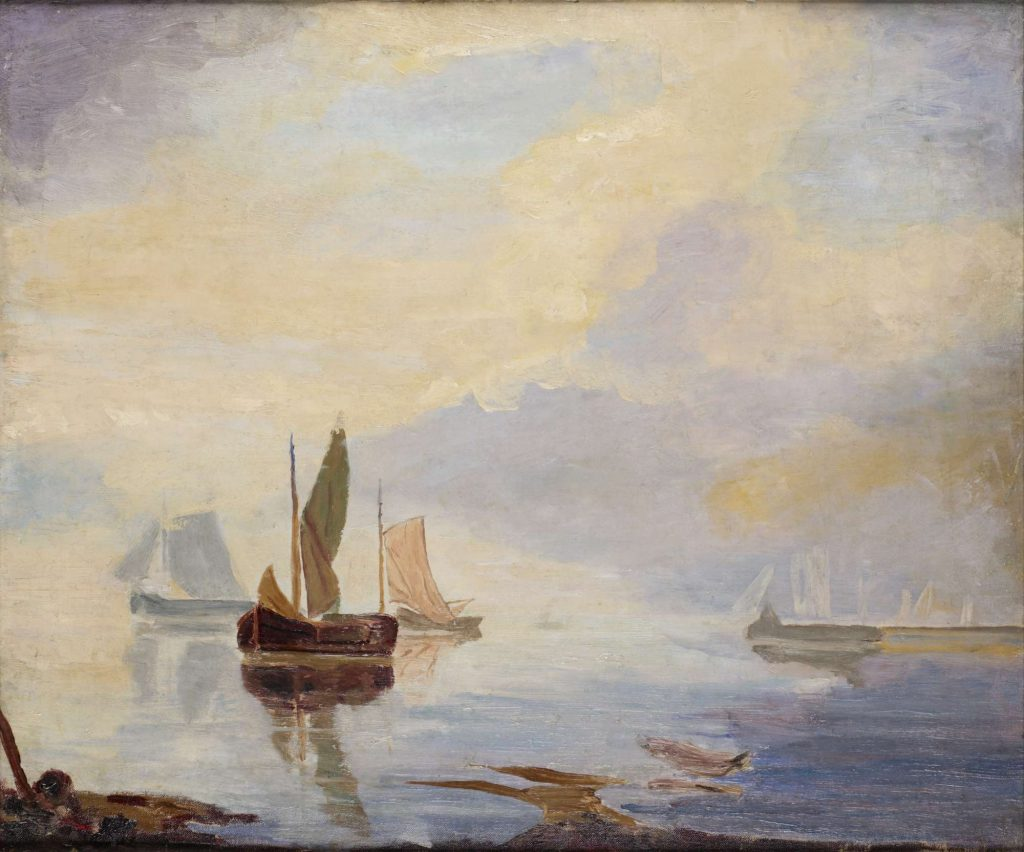 View of 3 sailing boats on the sea with a cloudy sky of yellow and mauve above
