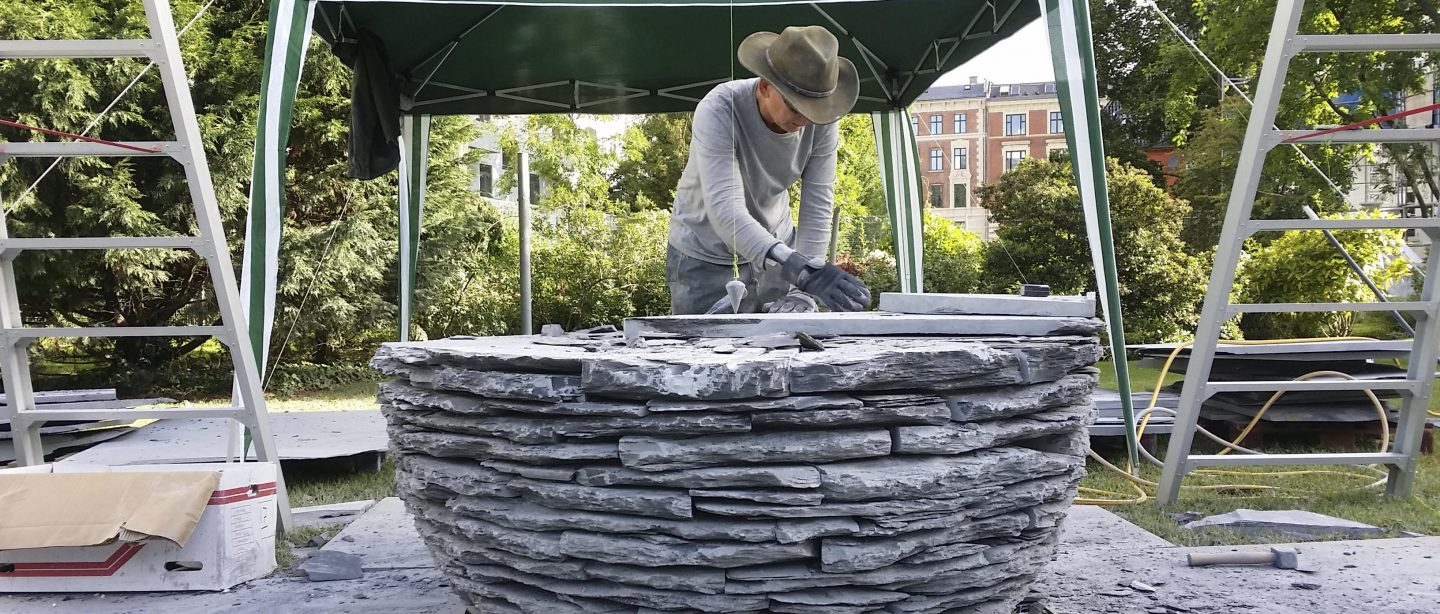 The artist in the process of installing the sculpture