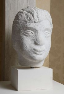 Stone sculpture of a boy's head