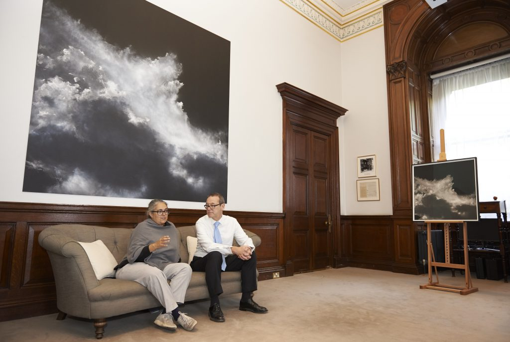 Tacita Dean and Sir Simon McDonald sitting in his office