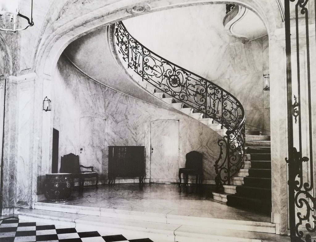 A marbled spiralled staircase in the British Residence in Budapest in 1925