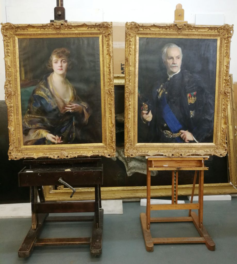 two paintings in the conservation studio