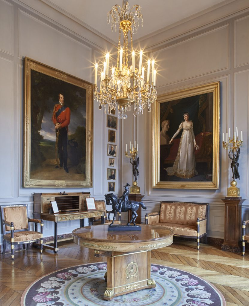 Two portrait paintings shown in a room at the British Embassy, Paris