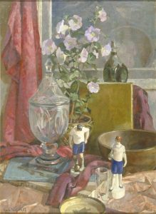 Still life with sport figurines and glass vase on table