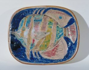 Pottery dish with fish on blue ground