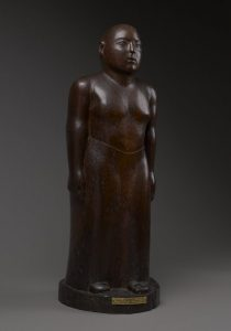 Wooden sculpture of a male figure