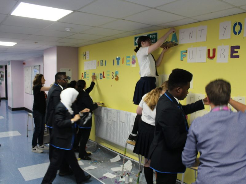 students making a mural in a school