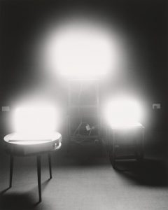 Three bright lights in a black and white photograph
